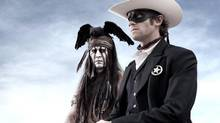 """This undated publicity photo from Disney/Bruckheimer Films, shows actors, Johnny Depp, left, as Tonto, a spirit warrior on a personal quest, who joins forces in a fight for justice with Armie Hammer, as John Reid, a lawman who has become a masked avenger, The Lone Ranger, from the movie, """"The Lone Ranger."""" The film opens nationwide on July 3, 2013. (Peter Mountain/THE CANADIAN PRESS)"""