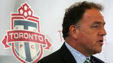 """Tom Anselmi COO of Maple Leaf Sports and Entertainment answers a reporters question about Toronto FC soccer coach Maurice """"Mo"""" Johnston at Scallywags bar on St. Clair W. on August 25, 2006.  (Jim Ross/The Globe and Mail)"""