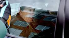 Vito Rizzuto sits in the back of a police car in Montreal on Jan. 20, 2004. (Luc Laforce/The Canadian Press)