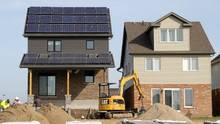 For their first net-zero home as part of the Eco-Energy program, Reid's Heritage Homes adapted one of their most popular home designs by adding a covered porch so they could accommodate 8 kilowatts of solar PV. (David Dodge/buildABILITY Corporation)