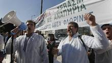 Residents of towns from northwestern Greece shout slogans during a protest against the hiking of taxes in heating fuel in Athens October 31, 2012. (YORGOS KARAHALIS/REUTERS)