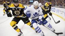Toronto Maple Leafs' Jay McClement (11) battles Boston Bruins' Chris Kelly (23) for the puck in the first period of an NHL hockey game in Boston, Saturday, Nov. 9, 2013. The two teams face each other again in Sunday NHL action. (Michael Dwyer/AP)