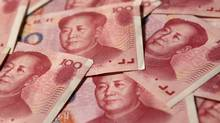 Yuan banknotes are seen in this illustrative photograph taken in Beijing September 19, 2010. (PETAR KUJUNDZIC/Reuters/PETAR KUJUNDZIC/Reuters)