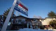 A sold sticker is seen on a for sale sign outside a home in Delta, B.C., on Dec. 15, 2016. (DARRYL DYCK For The Globe and Mail)
