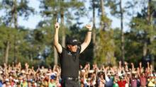 Golfer Phil Mickelson won the 2010 Masters tournament by making a daring yet calculated shot. (JOE SKIPPER/REUTERS)