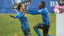 Montreal Impact's Matteo Mancosu, left, celebrates with teammate Dominic Oduro after scoring against the New York Red Bulls during second half action of the first leg of the eastern conference MLS soccer semifinal in Montreal on Oct. 30, 2016. (Graham Hughes/THE CANADIAN PRESS)