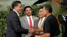 U.S. Republican presidential candidate and former Governor of Massachusetts Mitt Romney (L) greets a group of men who participated during a Hispanic roundtable meeting in Tempe, Arizona April 20, 2012. (Joshua Lott/Reuters/Joshua Lott/Reuters)