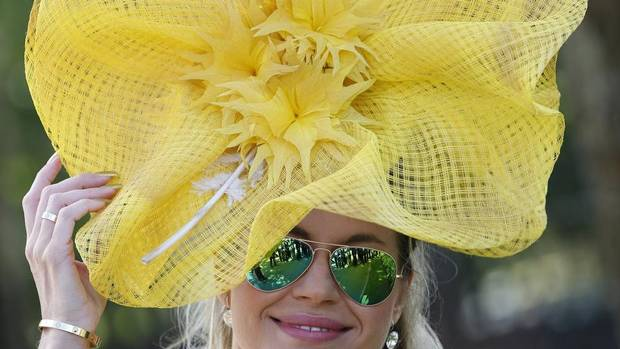 Ester Dohnalova shows off her hat on the first day of the Royal Ascot horse race in Ascot, England. (Alastair Grant/AP)