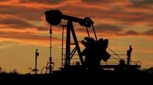 A pumping unit sucks crude oil from the ground near Manhattan, Kan. (AP Photo/Charlie Riedel) (Charlie Riedel/Charlie Riedel/AP)