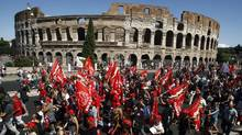 Demonstrators march past the Colosseum during a general strike in Rome, Sept. 6, 2011. A default by Italy would have devastating effects for Europe and the world. (Pier Paolo Cito/AP/Pier Paolo Cito/AP)