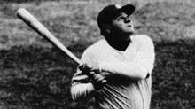 In this undated photo, Babe Ruth of the New York Yankees hits a home run. (ASSOCIATED PRESS)