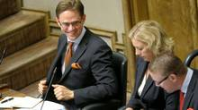 Finland's Prime Minister Jyrki Katainen, left, Minister of Finance Jutta Urpilainen and Minister of Defence Stefan Wallin attend a parliament session in Helsinki on Wednesday. The Finnish parliament backed extending the powers of the euro zone bailout fund. (LEHTIKUVA/REUTERS)