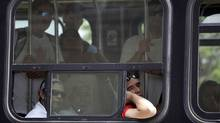 TTC riders in a hot streetcar in Toronto. (Fernando Morales/Fernando Morales/The Globe and Mail)