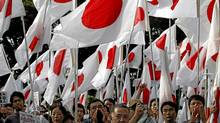 A sea of Japanese flags at a militant protest in Tokyo on Oct. 2 (Issi Kato/Reuters)