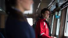 Prime Minister Justin Trudeau stands on the bridge of the Canadian Coast Guard ship Sir Wilfrid Laurier, during a tour of the harbour in Vancouver on Monday, Nov. 7. (Darryl Dyck/The Canadian Press)