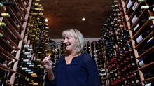 """Sommelier Véronique Rivest samples a glass of wine in the cellar of her restaurant Soif in Gatineau, Que. Rivest excels at discovering culinary pairings. """"I'll find you a wine for any food,"""" she says. (Dave Chan for The Globe and Mail)"""