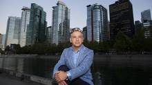 Tony Gioventu, executive director of the Condominium Home Owners' Association of B.C., is seen with condo towers along Coal Harbour's waterfront in Vancouver in August. (Rafal Gerszak for The Globe and Mail)