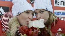 Kaillie Humphries and Chelsea Valois sip beer after winning a World Cup race in Winterberg, Germany, last week: 'I pinch myself all the time,' Valois says. 'I knew if I made Kaillie's team I would have some success, but this is absolutely awesome.' (Martin Meissner/AP)