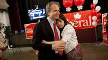 Liberal candidate for Parkdale High Park Gerard Kennedy gets a hug from daughter Theria after his defeat to the NDP candidate Peggy Nash in the federal election May 2, 2011. (Moe Doiron/The Globe and Mail/Moe Doiron/The Globe and Mail)