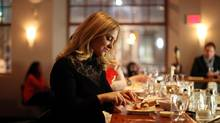 Setting your own pace, eating without the small talk and never having to share dessert and are just two of the advantages of dining alone, says Barbara Balfour, who's found a table for one here at Play Food & Wine Bar in Ottawa. (Dave Chan for The Globe and Mail)