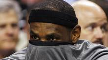 Miami Heat LeBron James covers his face with his shirt as he watches the second half of their NBA basketball game against the Boston Celtics from the bench at TD Garden in Boston, Massachusetts April 24, 2012. REUTERS/Jessica Rinaldi (Jessica Rinaldi/Reuters)