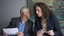 ForestEthics Advocacy Association spokesperson Tzeporah Berman, right, speaks with challenge applicant John Vissers during a news conference in Vancouver on Monday. (JONATHAN HAYWARD/THE CANADIAN PRESS)