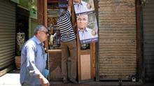 A man hangs posters of presidential candidate Ahmed Shafiq at his shop in Cairo, June 13, 2012. The Brotherhood's Mohamed Mursi will face Shafiq, the last prime minister of ousted leader Hosni Mubarak, in a presidential run-off on June 16 and 17, the climax of Egypt's first free leadership contest after 16 months of military rule. (Suhaib Salem/Reuters)