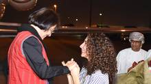 """This photo made available by Oman News Agency, shows retired Iranian-Canadian professor Homa Hoodfar, 1st left, arriving in Muscat airport, Oman, after being released by Iranian authorities, Monday, Sept. 26, 2016. Canadian-Iranian retired professor was released from prison on """"humanitarian grounds"""" and flown out of Iran on Monday, Iran's state-run news agency said, ending her months of detention alongside other dual nationals swept up by hard-liners in the security services. (Oman News Agency via AP) (Untitled/AP)"""