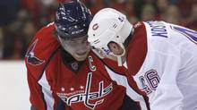 Washington Capitals' Alex Ovechkin (L) looks at Montreal Canadiens' Andrei Kostitsyn before a faceoff during Game 2 of their NHL Eastern Conference quarter-final series hockey game in Washington April 17, 2010. REUTERS/Molly Riley (MOLLY RILEY)
