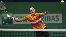 Canada's Milos Raonic returns the ball to Australia's Marinko Matosevic during the men's singles match at the Shanghai Masters tennis tournament in Shanghai October 9, 2012. (ALY SONG/REUTERS)