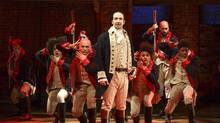 """In this photo released by The Public Theater, Lin-Manuel Miranda (foreground) performs with members of the cast of the musical """"Hamilton"""" in New York. (Joan Marcus/AP)"""