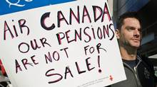 An Air Canada customer service agent pickets outside Trudeau airport in Montreal on June 14, 2011. (Graham Hughes/THE CANADIAN PRESS)