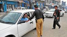 In this picture dated July 21, 2011, a Pakistani policeman searches a car at a check point in Swat valley. New threats risk delaying a handover to civilian leaders in Pakistan's Swat valley, where the army remains in force two years ago after stamping out a Taliban insurgency and restoring peace (A MAJEED/AFP/Getty Images)