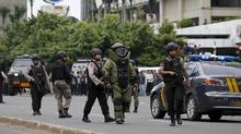 Indonesian police bomb squad members walk to the site of a blast at Thamrin business district in Jakarta, January 14, 2016. (BEAWIHARTA/REUTERS)