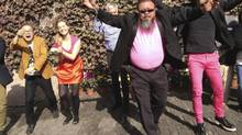 """Dissident Chinese artist Ai Weiwei (front) dances with his friends as they make a cover version of music video Gangnam Style by South Korean singer Psy at the courtyard of Ai's studio in Beijing in this October 24, 2012 file photo. Ai announced plans on March 11, 2013 to release a heavy-metal album that he said would """"express his opinion"""" just as he does with his art. (HANDOUT/REUTERS)"""