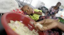 Children and their mothers receive food and treatment, mostly for severe malnutrition and measels, at a hospital in Mogadishu, Somalia, on Sept. 7, 2011. (Peter Power/The Globe and Mail/Peter Power/The Globe and Mail)