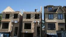 Houses under construction in Toronto last year. Prices in the city surged by more than 20 per cent in September 2016. (Graeme Roy/The Canadian Press)