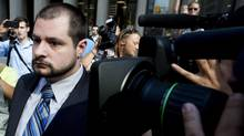 City of Toronto Police Constable James Forcillo leaves the court house after being granted bail. Forcillo has been charged with second degree murder from the shooting of 18-year-old Sammy Yatim in Toronto. (Nathan Denette/THE CANADIAN PRESS)