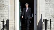 Canadian Prime Minister Stephen Harper walks out of the front door 24 Sussex to meets Australian Prime Minister Tony Abbott Monday June 9, 2014 in Ottawa. The income splitting program would allow the higher earning spouse to transfer up to $50,000 to the lower earner for tax filing purposes. (Adrian Wyld/THE CANADIAN PRESS)
