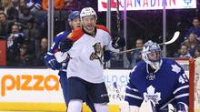 Florida Panthers right-wing Logan Shaw (48) celebrates a goal by Jussi Jokinen (not pictured) against the Toronto Maple Leafs at Air Canada Centre. The Panthers beat the Maple Leafs 4-1. (Tom Szczerbowski/USA Today Sports)