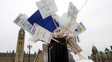 Discarded placards overflow from a garbage bin on Parliament Hill following a demonstration in support of Nortel pensioners on Parliament Hill in Ottawa, Wednesday October 21, 2009. THE CANADIAN PRESS/Adrian Wyld (Adrian Wyld/The Canadian Press)