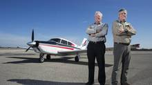 Chris Elgar, left, will join fellow pilot Dave McElroy to fly around the world in 80 days, raising funds for autism research. (Peter Power for The Globe and Mail)
