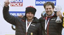Canada's Justin Kripps (left) and Jesse Lumsden celebrate their second place finish after the men's two-man bob race at the Bobsleigh and Skeleton World Championships at Lake Koenigssee, Germany, on Feb. 19. 2017. (Angelika Warmuth/AP)