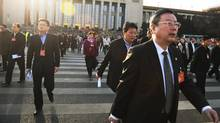 Delegates walk out after a plenary session of the Chinese People's Political Consultative Conference (CPPCC) in Beijing on Thursday. The group advises the National People's Congress, China's legislature. (GREG BAKER/AFP/Getty Images)
