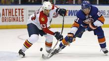 Florida Panthers defenseman Mike Weaver (43) defends in front of the crease with New York Islanders right wing Kyle Okposo (21) defending in the second period of an NHL hockey game at Nassau Coliseum in Uniondale, N.Y., Sunday, March 2, 2014. (Associated Press)