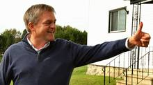 Progressive Conservative Leader David Alward gives a thumbs up as he leaves a polling station in Benton, N.B., on Sept. 27, 2010. (PAUL DARROW/REUTERS)