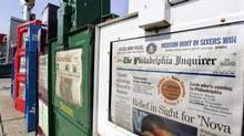 Newspaper boxes on display on the streets of Philadelphia. (GEORGE WIDMAN/AP)