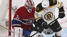 Montreal Canadiens goalie Carey Price (L) makes a glove save against Boston Bruins' Rich Peverley during second period of their NHL action in Montreal, February 6, 2013. (CHRISTINNE MUSCHI/REUTERS)