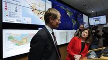 Canada's Federal Minister of Health Rona Ambrose tours the Emergency Response Center with Dr. Gregory Taylor at the National Microbiology Lab in Winnipeg, Manitoba, November 3, 2014. (LYLE STAFFORD/REUTERS)