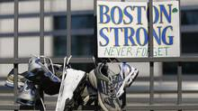 Gates outside the U.S. Embassy in Ottawa following a walk from Parliament Hill in memory of the victims of the Boston Marathon bombings. (CHRIS WATTIE/REUTERS)